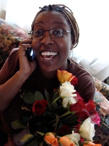 Deesha Philyaw with Mother's Day Roses and Her Cell Phone