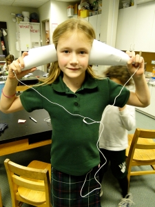 An Ellis Student with Her 'Hacked' Ear Bud Amplification Device